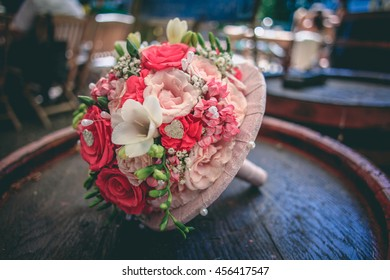 Wedding bouquet with pink flowers on wooden background