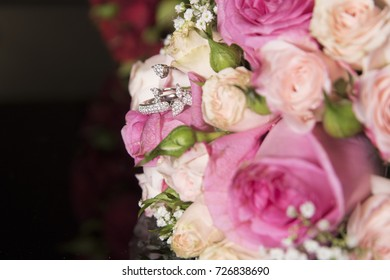 wedding bouquet of pink roses with rings