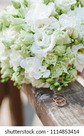 Wedding bouquet with rings on a tree