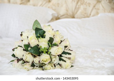 Wedding bouquet of roses hand-made on the bed