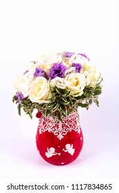 A wedding bouquet from roses and lilac freesias