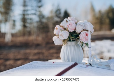 wedding bouquet in a vase is on the table