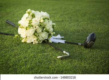 Wedding bouquet of white flowers on the golf field