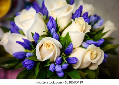 Wedding bouquet of white roses and blue hyacinth. Delicate white gentle roses and little blue flowers wedding bouquet. Beautiful wedding bouquet white roses, blue hyacinth. Wedding bouquet background