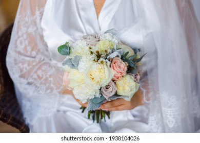 Wedding bouquet with white roses and dew.