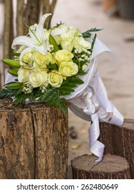 wedding bouquet of White roses & white Lily
