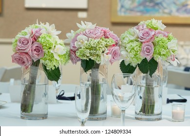 Wedding bouquets on table at reception dinner party