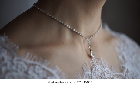 Wedding bracelet and necklace. Woman trying on jewelry bracelet. Bride with treasure. Woman with jewelry. Girl with fashionable jewelry, earrings, bracelets and necklace