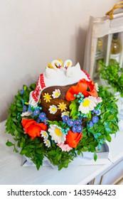 wedding bread in Ukrainian traditions, with field flowers