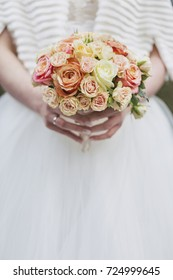Wedding. Bridal bouquet of rose flowers in hands