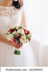 Wedding bridal bouquet of roses, chrysanthemums, Eucalyptus Baby Blue in the hands of the bride. Wedding in Montenegro, Adriatic.