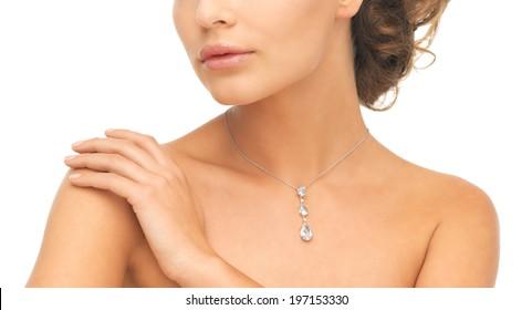 wedding, bridal jewelry and luxury concept - beautiful woman wearing shiny diamond necklace