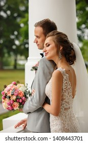 Wedding. Bride and Groom embracing after wedding ceremony. Portrait of beautiful newlyweds