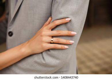 Wedding. Bride and groom holding after wedding ceremony. Wedding ring on bride's finger