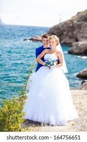 wedding: bride and groom on the seashore