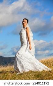 Wedding bride standing in grass