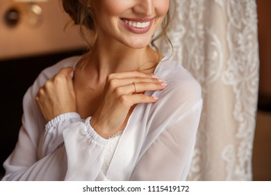 Wedding. Bride with white teeth smile and engagement ring on finger on wedding dress background. Marriage concept