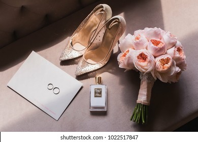 wedding. bride's shoes, perfume and wedding bouquet on the table