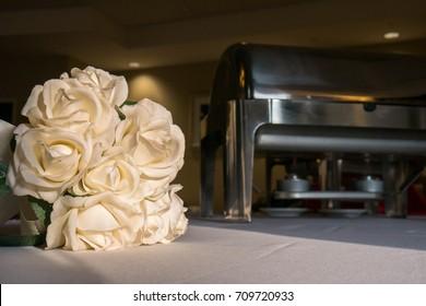 Wedding buffet setup, and bouquet.