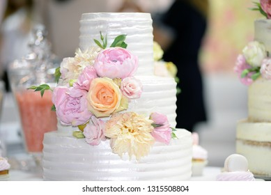 Wedding cake decoration with colorful flowers, it is served at wedding receptions. Vintage style for weddings, birthdays.