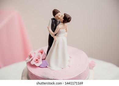 Wedding cake and figure bride and groom on the cake