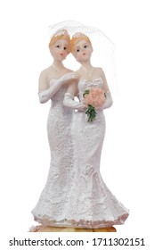 wedding cake figurine of female couple on white studio isolated background