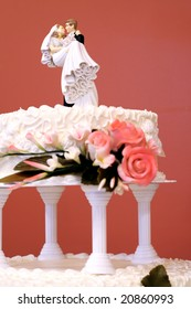 Wedding cake  (focus on bride and groom)