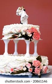 Wedding cake ( focus on bride and groom)