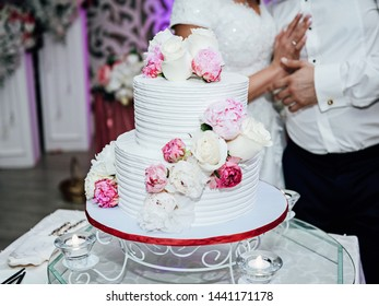 Wedding cake and groom with the bride