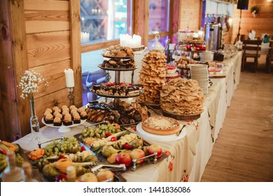 Wedding cake table background. Sweet and delicious restaurant desserts.