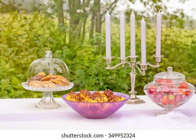 wedding cakes with candlestick on white table in forest
