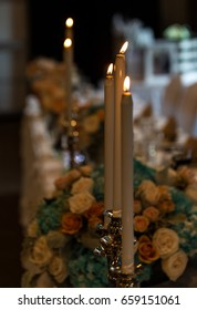Wedding candles on the bridal party head table