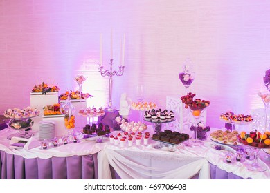 Wedding candy bar, decorated table with sweets and flowers, baked goods.
