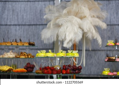 Wedding candy bar decoration setup with delicious cakes and sweets