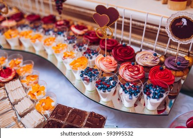 Wedding candy bar with makaroons and fruits.