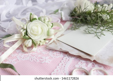 wedding card design. wedding invitation. White roses on a pink background, wedding rings and an envelope.