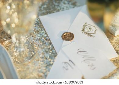 Wedding card design. Postal card design. Sealing wax stamp. Golden background.