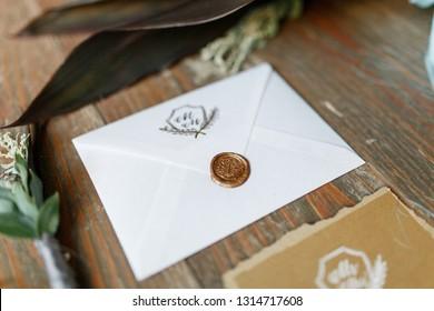 Wedding card design. Postal card design. Sealing wax stamp. Golden background. Calligraphic design elements.