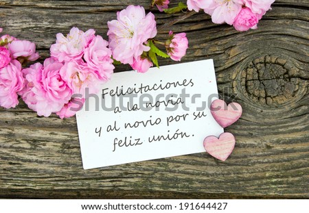 wedding card with pink blossomscongratulations to the bride and groom on their happy marriage
