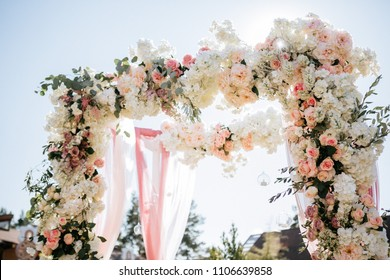 Wedding ceremony arch decor on blue background