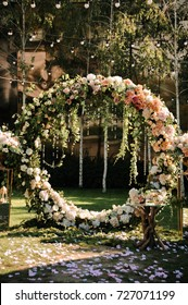 Wedding. Wedding ceremony. Arch. Arch, decorated with pink and white flowers standing in the woods, in the wedding ceremony area