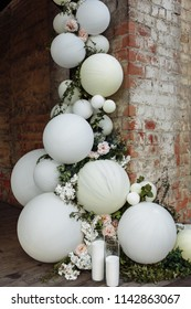 Wedding ceremony with beautiful decoration . Pink flowers, white balloons .