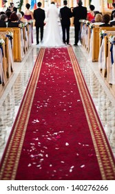 Wedding ceremony in church - focus on red carpet