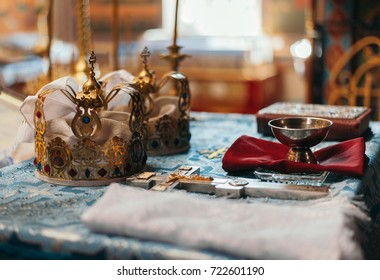 wedding ceremony crowns and church bowl