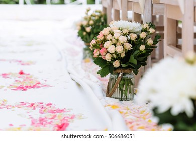 wedding ceremony decorations, rose petals, bouquet in vase