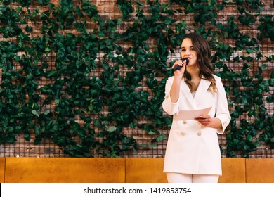 wedding ceremony. Master of ceremonies with microphone and photo zone