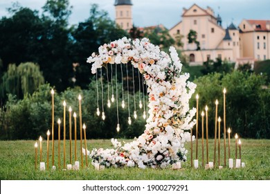 Wedding ceremony on b street near the Nesvizh castle.Decor with fresh flowers in the form of the moon