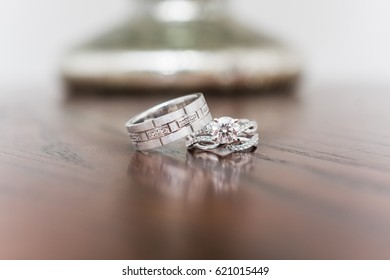Wedding ceremony rings, his and hers, brown background, silver or white gold, diamond and diamonds