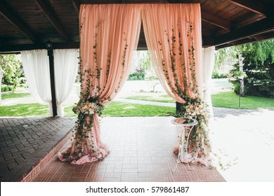 Wedding ceremony in rose colors in the restaurant