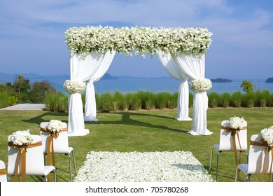 Wedding ceremony set-up on a green lawn in the summertime.